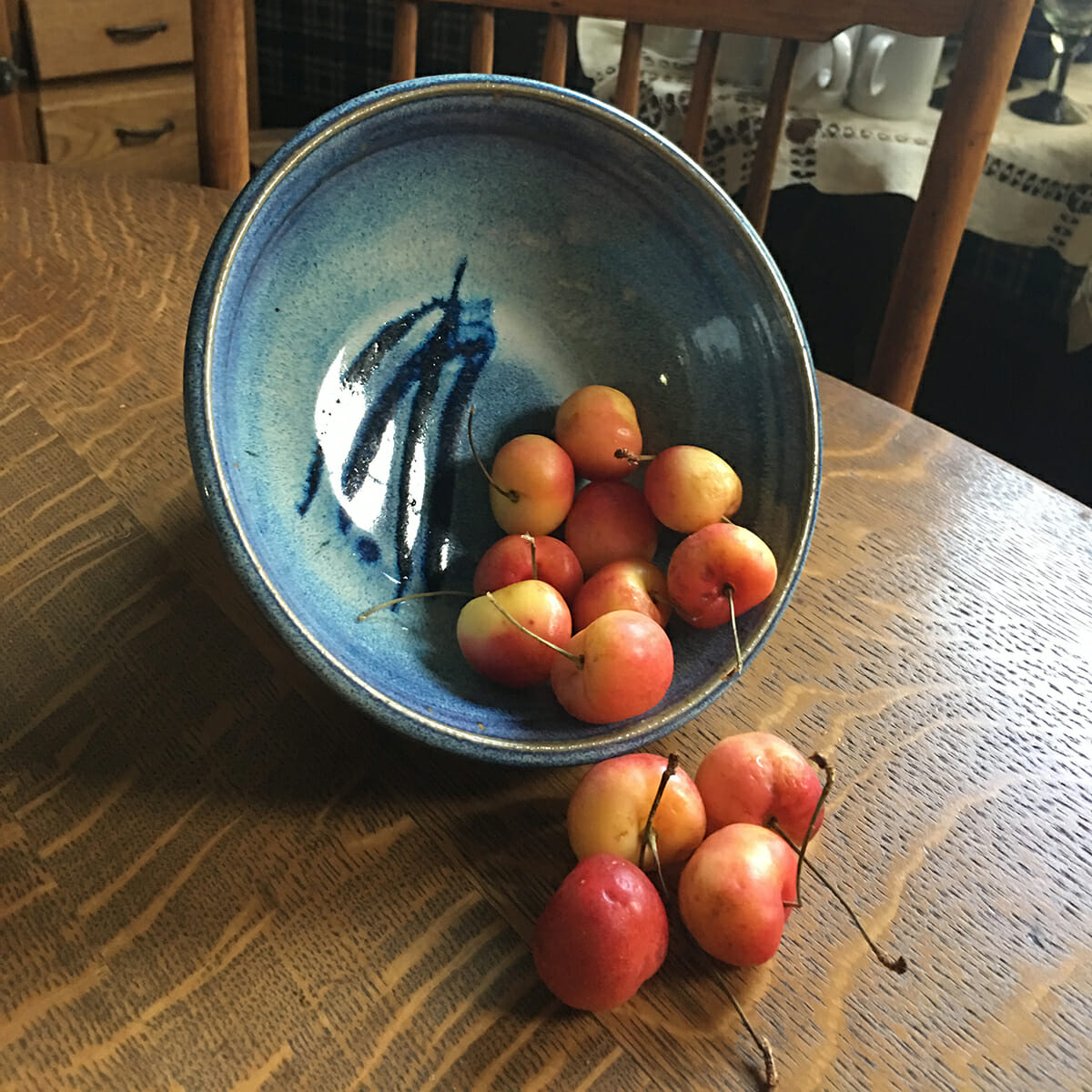 Bowl, low small, in Rutile Blue Glaze, Smooth Design -cherries