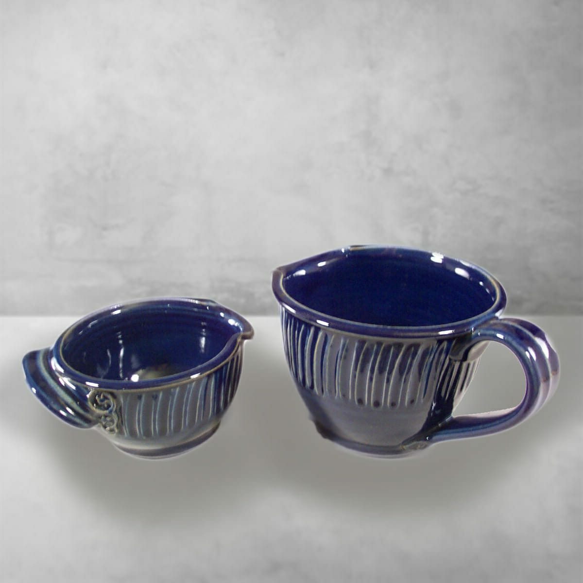 Spouted Bowls with Handles, Small and Large Sizes, Fluted Design in Dark Blue Glaze.