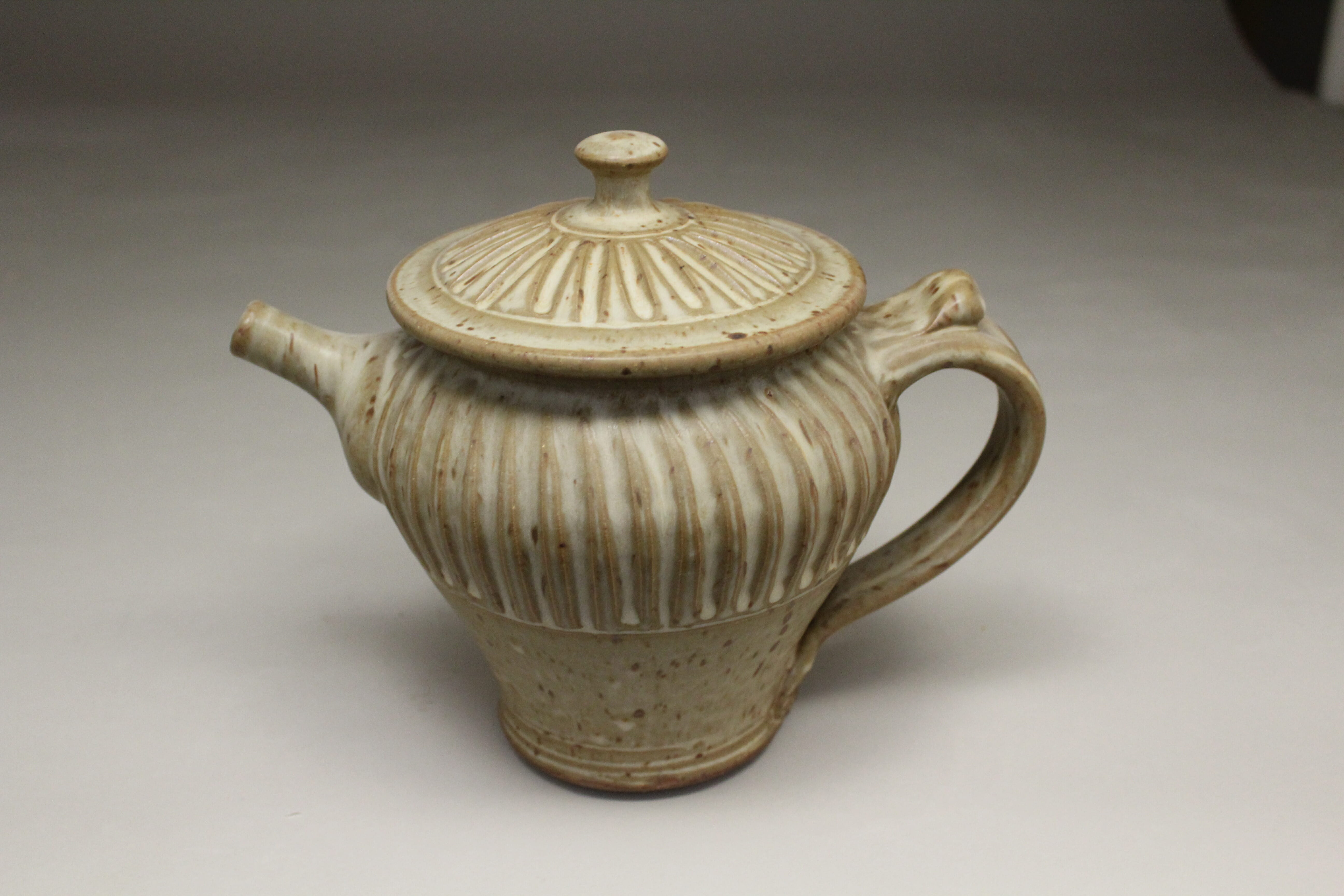 Spouted Teapot with Lid and Handle Fluted Design in Spodumene Glaze