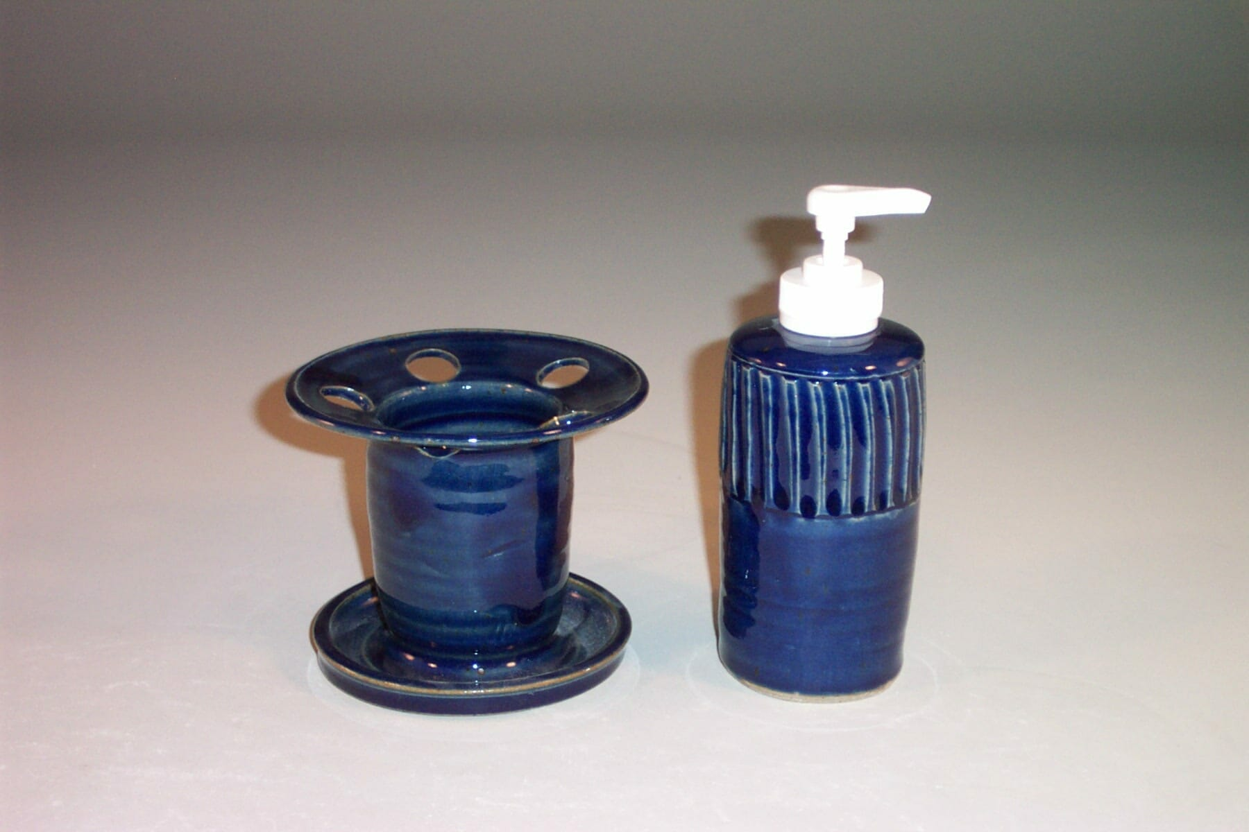 Toothbrush Holder and Soap Dispenser Fluted Design in Dark Blue Glaze